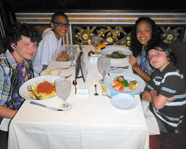 THE KIDS HAVING DINNER ON THE SHIP