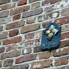 Fire company insigna. Many years ago there were over 30 fire companies in Charleston. You paid your dues and put the fire Co. insigna on your wall and if you had a fire the Co. with that insigna would respond a extingush the fire.