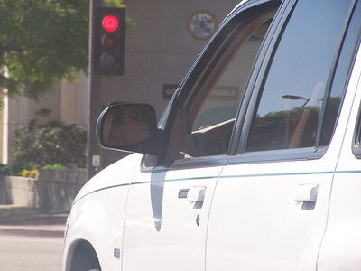 Monday: Downtown Glendale.  This woman got in the way of my shot, so I took a picture of her through her rearview mirror.