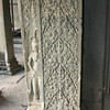 Decorative carving and devata at Angkor Wat