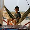 Boy in hammock on boat