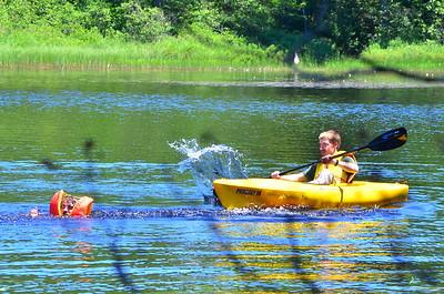 Kyle splashing his brother.