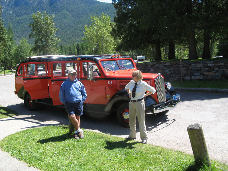 Glacier National Park. These red buses will give you a tour of the whole park. Unfortunately, the higher parts of the park were still snowed in in early July.