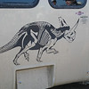Dinosaur Provincial Park in Alberta, Canada. Source of a huge collection of complete dinosaur bones. This bus has a drawing of a dinosaur named after Alberta.