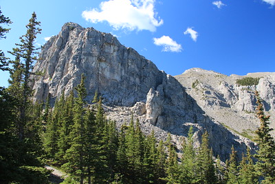 "The trail goes up to the side of Mt. Yamnuska and through a narrow passage on the right side which is referred to as ""the chimney""."