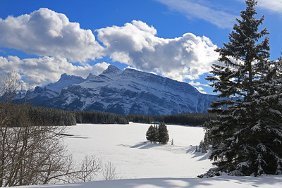 The backside of Mt. Rundle over Two Jack Lake.