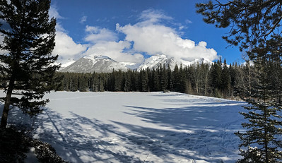 Looking across Johnson Lake at mountains in the Vermillion Range.