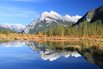 Near perfect reflection of Mt Rundle in the third Vermillion Lake near the town of Banff.