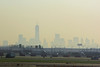 New York City through the haze with the new World Trade Center dominating the skyline.