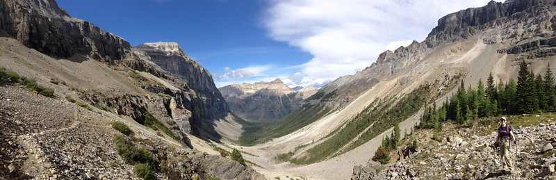A panorama of the Stanley Glacier valley from the plateau at the end.  The trail on the left is the one we came up.  That's Ginny on the right.