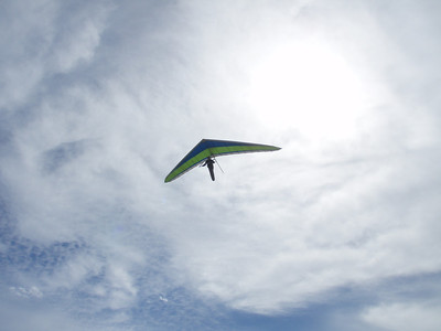 Hang gliders and parasailers playing at Surfers Beach and riding the wind up and down the length of the dunes.  Jealous.