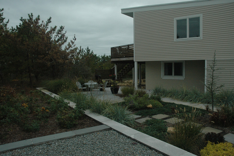 Cape House - new landscaping and siding