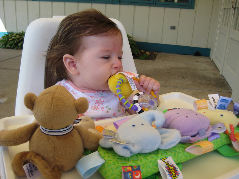 Delaney sits in a high chair for the first time at Cooke's in Hyannis.