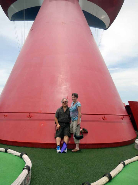 Rick & Wendy on the Carnival Destiny. This boat has a putting green, which was popular with the kids.