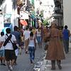 Street artist walking along Paseo de Obispo