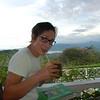 Kim drinking a cocnut on the veranda of Green Castle Estate
