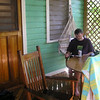 Alan on the deck of Monkey LaLa, our beach house rental on Roatan