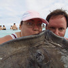 Stingray City Cayman Islands<br /> the photographer wanted the best so we had to kiss the stingray<br /> weird face but when you have a stingray in your face, kinda weird too
