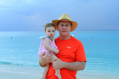 Don holding Quinn on 7 Mile Beach, CI 12-26-2013.