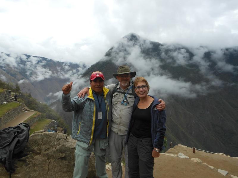 Our guide Edgar from the trek, Kim and Alan reach Machu Picchu.