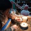 Jewelry craftsman making silver jewelry in Pisac