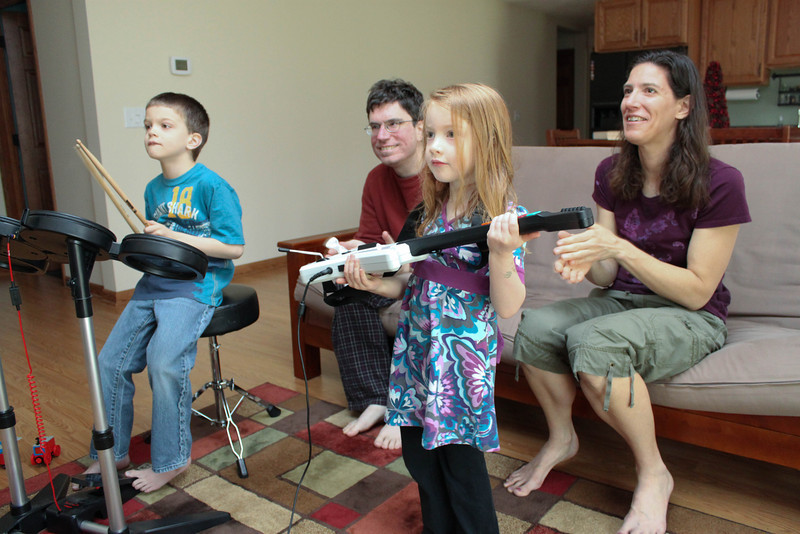 Kids jammin at uncle Mike's video game cave.