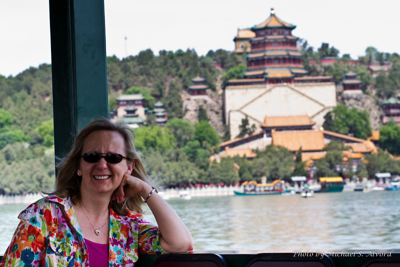 Crossing the lake at the Summer Palace. That is a Buddisht temple in the background, we saw lots of them everywhere in China.