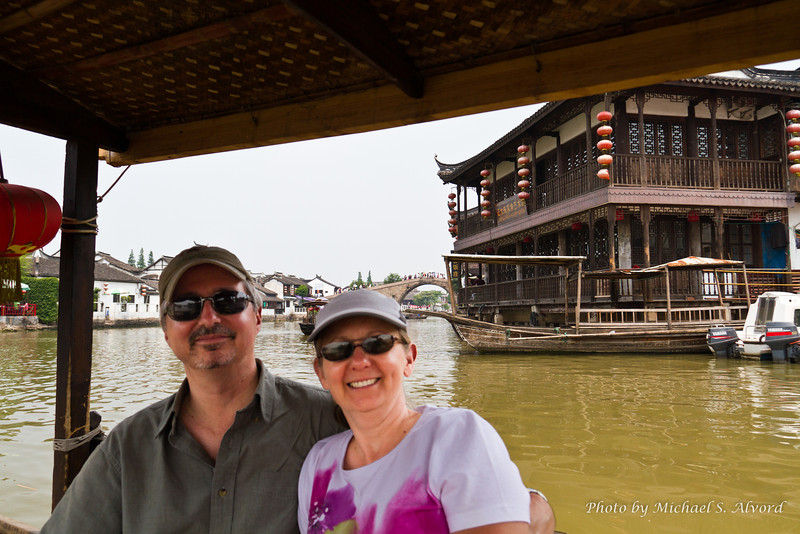 On a boat ride in Shanghai Venice.