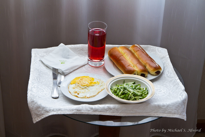 This was my 'western' breakfast. They don't have cereal, so I usually was given a egg, some type of bread and some type of salad. Usually the drink was either pomegranate juice which you see here, or tomato juice.
