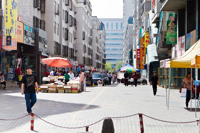 Looking down the food market street near Makor's building.