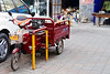 This is one of the many delivery carts that are all over China. This one is motorized, but many are just bikes.