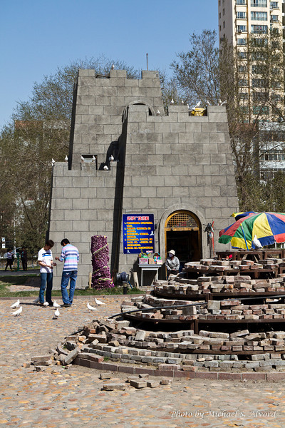 While I was at the park I found out that this building is actually a Pigeon house and the people feed the pigeons so they stay there. They were rebuilding the walkways, flower beds, and this small stone platform while I was there. By the end of my 3 weeks everything was finished and the park looked great.