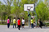 Basketball is very big in China and there are basketball hoops in a lot of places.