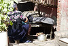 Here was a woman washing clothes in a kitchen pot.