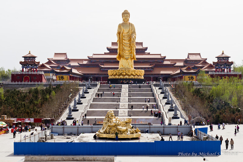 After passing through the temple arch this is the view. Notice that the Buddha at the bottom is called the 'laughing' Buddha, but the one standing is the real Buddha.
