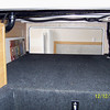 Huge HEATED side to side storage compartment.  Left to right side view.