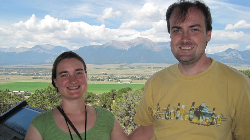 July13, 2012 (Collegiate Peaks Overlook / Buena Vista, Chaffee County, Colorado) -- Katie & Jon in front of Mount SLU [Mount Saint Louis University is the designated sand pile that is visible in front of Mount Princeton and between Katie and Jon]