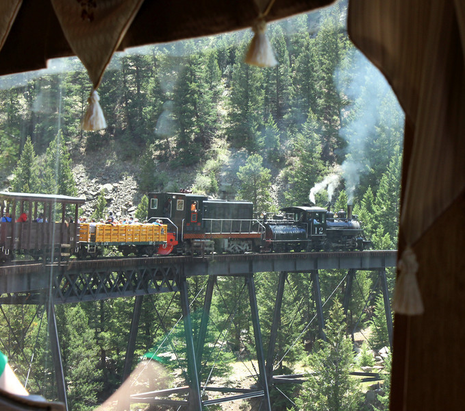 July 10, 2012 (Georgetown Loop Railroad [from 1st Class car window] / Georgetown, Clear Creek County, Colorado) -- Steam train crossing trestle [1st class car is now last car]