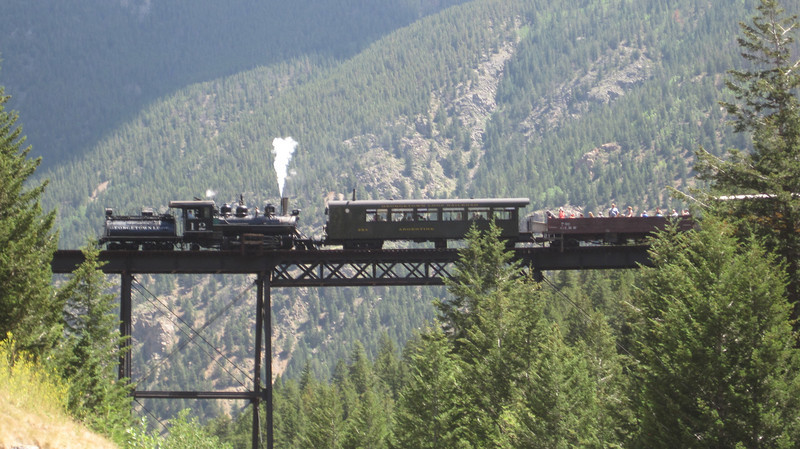 July 10, 2012 (Georgetown Loop Railroad [from Devil's Gate Station] / Georgetown, Clear Creek County, Colorado) -- Steam train crossing trestle from previous run to pick us up