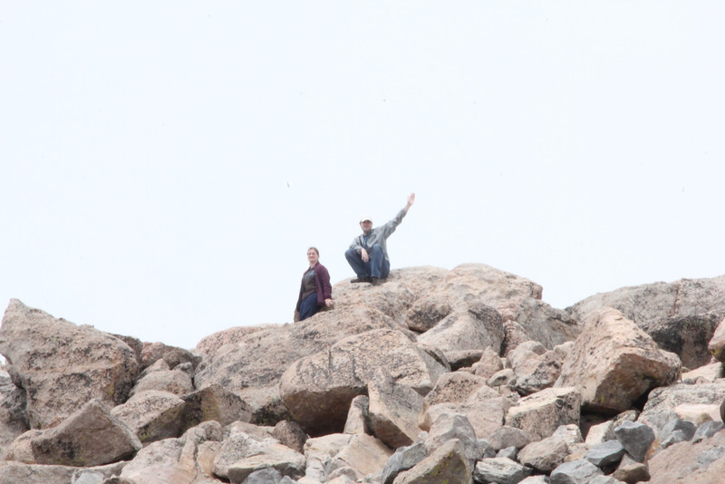July 9, 2012 (Mount Evans [photo from the summit parking lot] / Idaho Springs, Clear Creek County, Colorado) -- Katie & Jon [in the clouds] climbed from the parking lot to the summit