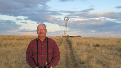 October 9, 2010 - (Pawnee National Grasslands [Murphy's Pasture] / Weld County, Colorado) -- David in front of a windmill water pump