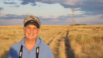 October 9, 2010 - (Pawnee National Grasslands [Murphy's Pasture] / Weld County, Colorado) -- MaryAnne in front of a windmill water pump