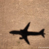our shadow...<br /> <br /> just before touch down at Denver International Airport...