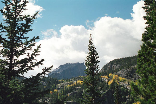 Rocky Mountain National Park; taken in October 2000.<br /> I like this image because of the golden aspens and dramatic clouds moving in.