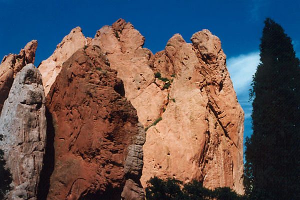 Shades of red at the Garden of the Gods.<br /> These rock formations are actually very large<br /> and climbers on them appear to be very small.