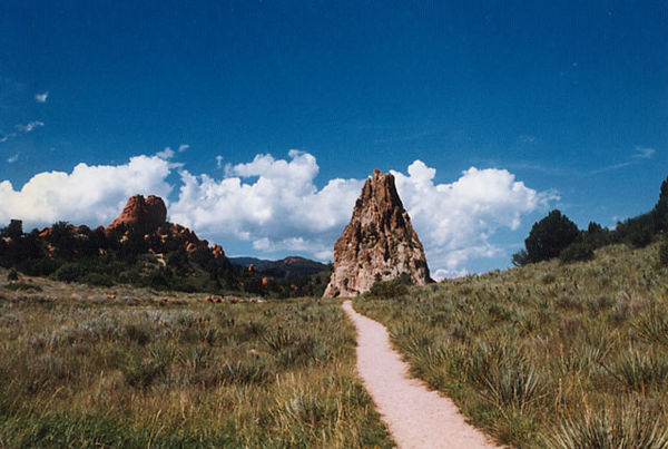 "Garden of the Gods.<br /> I like to call this photograph ""the lonely trail"" just because it appears that way in this image.<br /> The cone shaped rock formation seems odd and out of place to me."