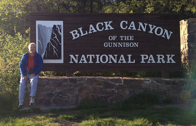 June 6, 2014 - (Black Canyon of the Gunnison National Park [entrance] / Montrose, Montrose County, Colorado) -- David with signage