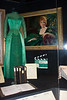"Amanda Blake's portrait and one of Miss Kitty's dresses.  It said that Ms. Blake designed the dress.  You can also see a ""take"" board from one of the episode's under her portrait.  A 3-ring binder contains an episode's dialogue."