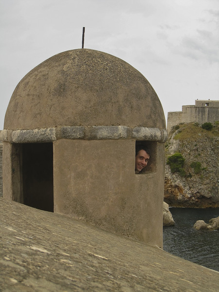 Francois peeking out of the window of a watchtower