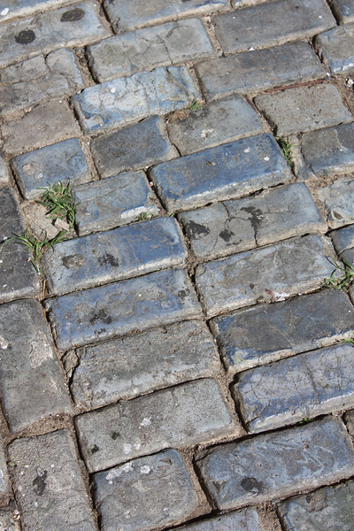 Some of the streets are paved with bricks that were used as ballast on ships coming over from Spain.  They are glazed with blue tint.